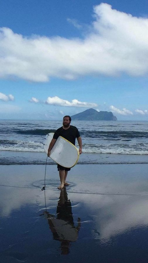 James Boyer on the Wai-ao Beach in Yilan County, Taiwan, after surfing.