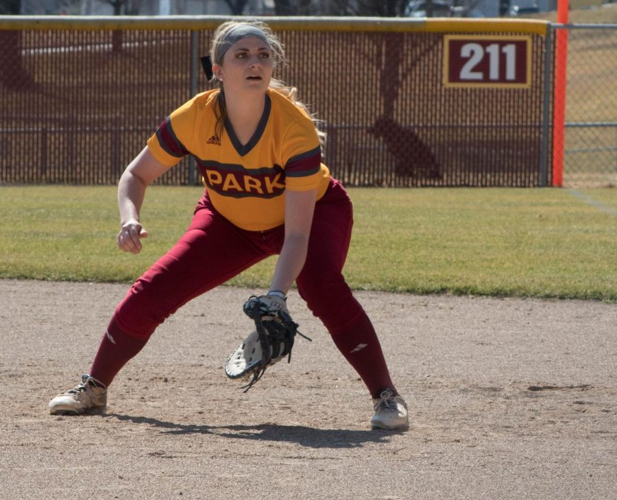 Katie Carr (Junior) at first base focused on the batter.
