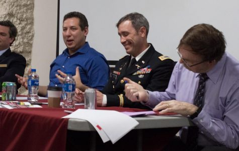 From left: Dr. Jack A. MacLennan, Dr. Jacob Stoil, Major Joe Evans, and Dr. Pete Schifferle held a panel to discuss defense spending and geopolitics