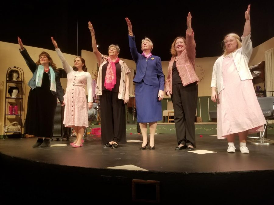 The cast of Steele Magnolias standing on stage in the David Theater at Park University, in order from left to right: Truvy, played by Shelly Richards; Shelby, played by Kim Hentges; Ouiser, played by Vicki Kerns; Clairee, played by Linda Levin; M'Lynn, played by Nancy Nail; and Annelle, played by Gina Drapela