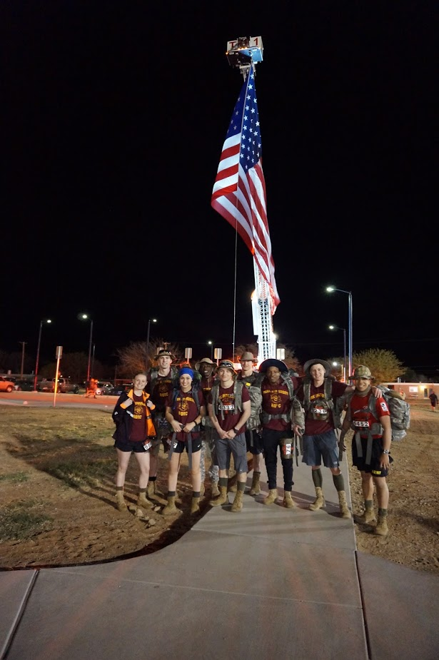 Park's ROTC members posed by the U.S. flag after the 26 mile tribute