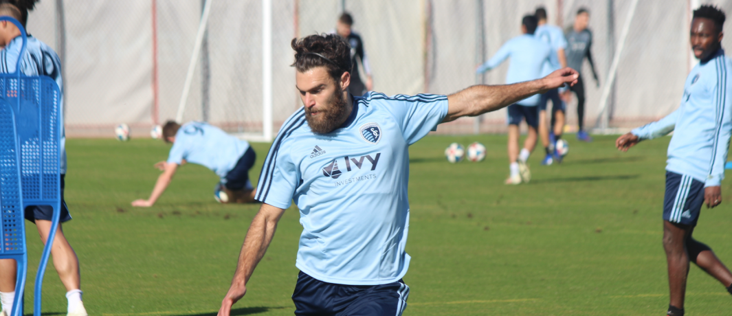 Graham Zusi lining up a strike on goal during a training session.