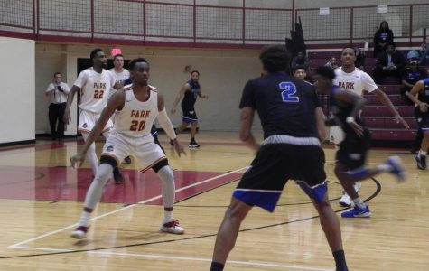 Senior guard Deionte Wilson defends against a Williams Baptist player with junior forward Ernest Myles III behind him.
