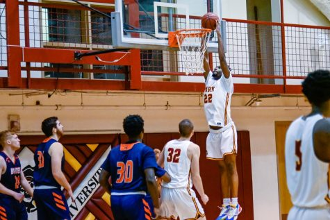 Senior forward Ernest Myles III rises for a dunk as sophomore forward Augusto Hausmann watches on.