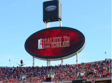 billboard at Arrowhead Stadium that says Salute to Scholars with Park emblem