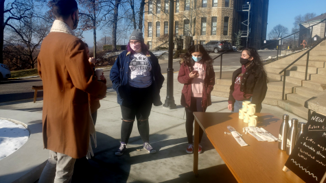 members of PSAB stand by a table