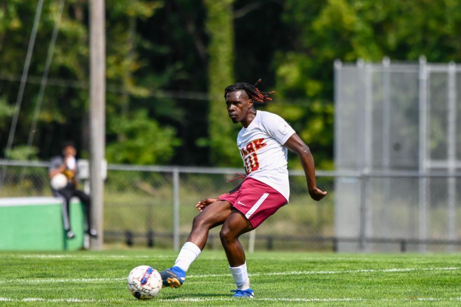 Rama Emeka Aniakor kicks the ball down Julian Field.